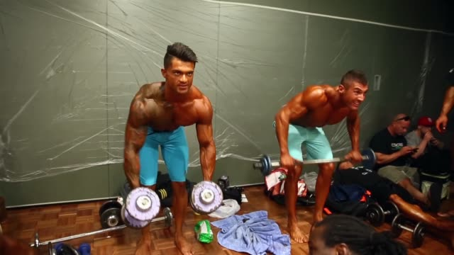 Competitors prepare backstage during the 2014 IFBB Victorian Bodybuilding Championship on October 05 2014 in Melbourne Australia