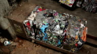 Compilation of crushed tin cans recycled in bales