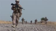 Compilation of footage of US Marines on patrol and training Afghan police in Garmsir district in southern Helmand province as well as female US...