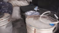 Components used to manufacture chemical weapons confiscated from Islamic State by Iraqi government troops