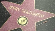 Composer Jerry Goldsmith who wrote the Star Trek soundtrack and won an Oscar for The Omen score in 1976 is honored with the 2611th star posthumously...