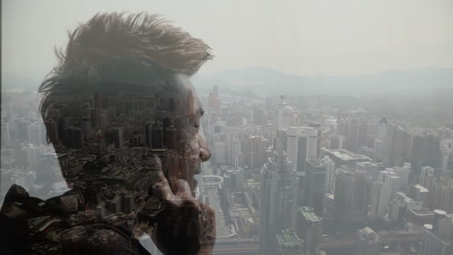Composite image of man talking on mobile phone and city