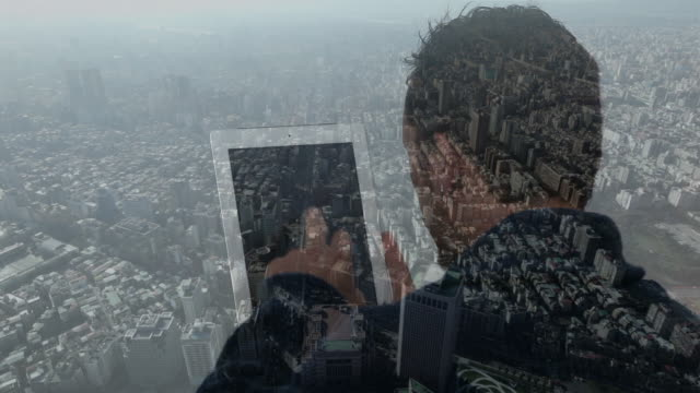 Composite image of man using tablet device and city