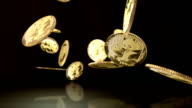 Computer generated Chinese gold coins falling  and bouncing off reflective surface