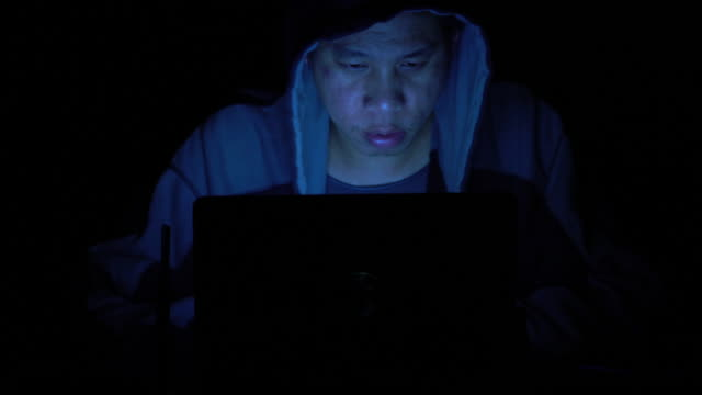 Computer hacker working at night