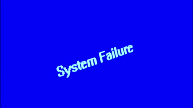 CU ZO computer screen with 'System Failure' message under swinging overhead light in dark room