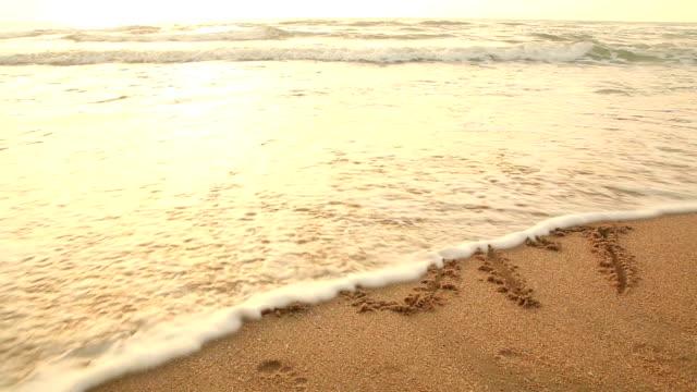 Concept: Tekening 2017 op het strand op Nieuwjaar moment