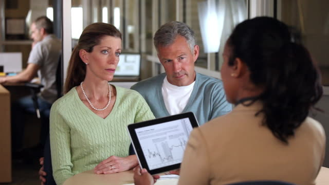 MS Concerned Adult Couple Discussing Retirment Planning with Financial Advisor / Richmond, Virginia, USA