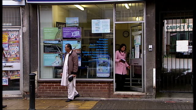 Concerns over AlMadinah Free school's financial management Derby 'Mortgage insurance Centre' shop on high street Office window Reporter to camera