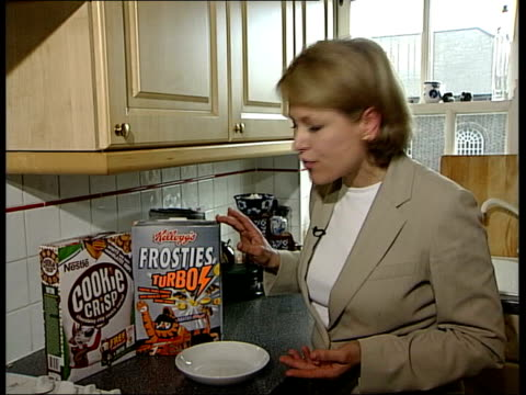 Concerns over breakfast cereals ITN i/c in kitchen with boxes of Nestle Cookie Crisp Kellogg's Frosties Turbos and Kellogg's AllBran three of the...