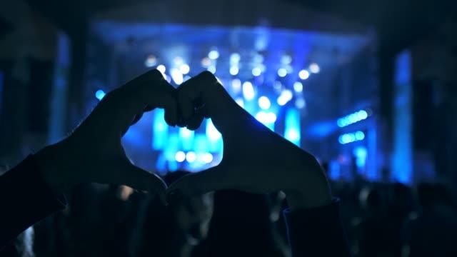 Concert fans.
