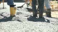 Concrete Workers Pouring and Troweling a New Driveway