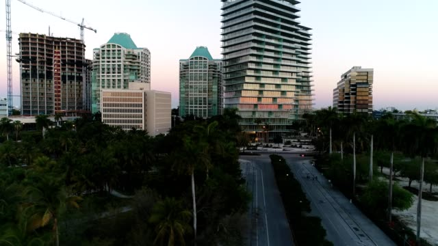 Condos businesses & construction within Coconut Grove's skyline at sunrise