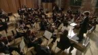 CS WS Conductor leading orchestra / London, United Kingdom