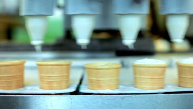 Cones filling with ice cream