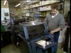 Day 1 Unknown Location MS Man standing by printing machine TCMS Hand working control on machine LA Another man turning handle on machine TX