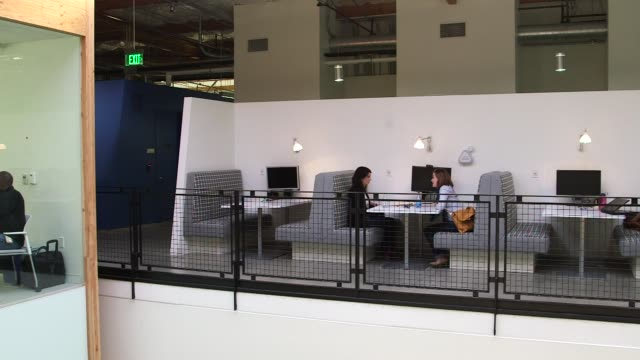 Conference rooms and pantry area at Google Global Headquarters in Mountainview California US on March 26 Pan of conference room with a glass wall and...