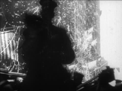 B/W 1927 confetti falling in ticker tape parade for Charles Lindbergh / newsreel