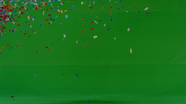 Confetti shower on green