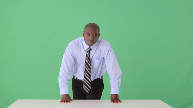 Confident African-American businessman standing with arms crossed