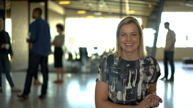 Confident disabled businesswoman in office