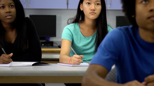 Confident Female Student Interacts in Classroom Setting