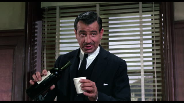 Confident man (Walter Matthau) explains job working for CIA to woman (Audrey Hepburn)