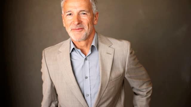 Confident senior business man smiling