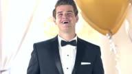 Confident teenage boy wearing tuxedo