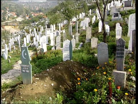 Conflict Blinded man returns ITN BOSNIAHERZEGOVINA Srebrenica LMS Sead Bekric blinded by Serbian shell during Bosnian war along thru cemetery...