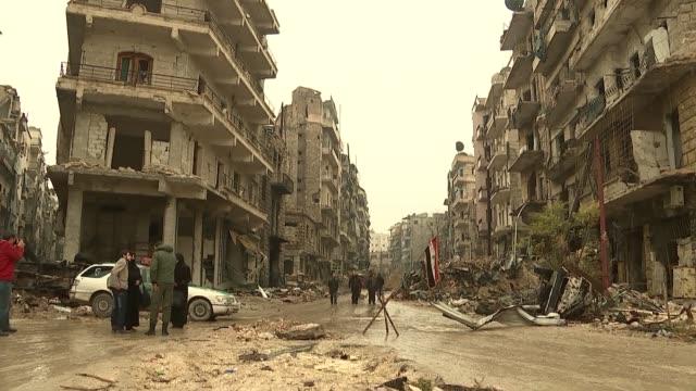Bushtan al Bashr neighbourhood Aleppo SYRIA Aleppo Western Aleppo Bushtan al Bashr neighbourhood EXT Various of buildings damaged by shelling and...
