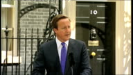 David Cameron MP press conference ENGLAND London Downing Street EXT David Cameron MP out of Number Ten as along to podium David Cameron MP statement...