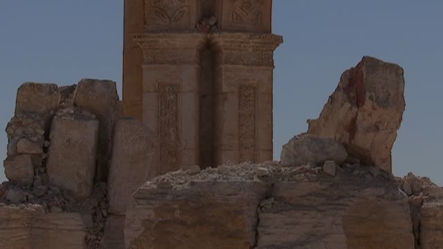 Devastation of Palmyra Palmyra ruins including graffiti / Soldier with Syrian flag / Soldiers among ruins Joanne Farchackh interview SOT re...