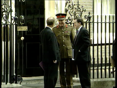 Kosovo Commons Debate ITN ENGLAND London Westminster i/c Downing Street Robin Cook MP speaking with George Robertson MP and General Sir Charles...