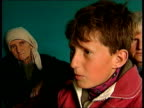 Kosovo Refugees ITN ALBANIA Kukes Selim Shala interview SOT Talks of NATO attack on convoy Krasnichi and others in tent Injured foot of man Sadri...