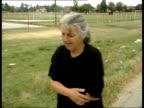 Kosovo Serb Farmers Massacred ITN YUGOSLAVIA Serbia Kosovo Gracko i/c GLS Combine harvester in field where bodies of murdered Serb farmers were found...