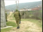 Rebels in newly captured mountain village ALBANIA Near Tepelene EXT General views of armed rebels on hill in newly captured mountain village / rebel...