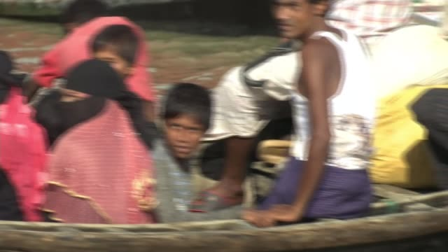 Thousands of Rohingya children suffering in refugee camps BANGLADESH Kutupalong refugee camp EXT Group of children laughing jumping up and down and...