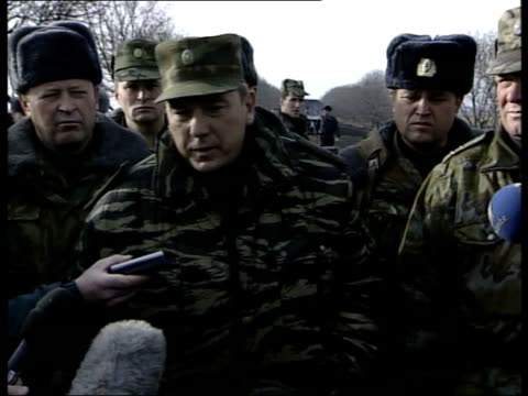 Chechnya Russia Backs Down on Bombing Deadline ITN FEDERATION CHECHNYA UrusMartan EXT MSs Russian armoured personnel carriers towards past along...