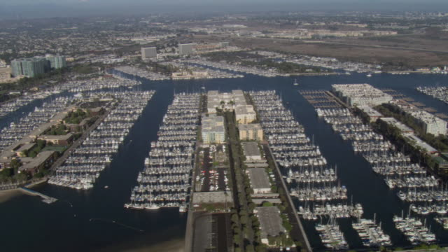 AERIAL Congested Marina del Rey Harbor lined with boats parked in slips / Santa Monica, California, United States