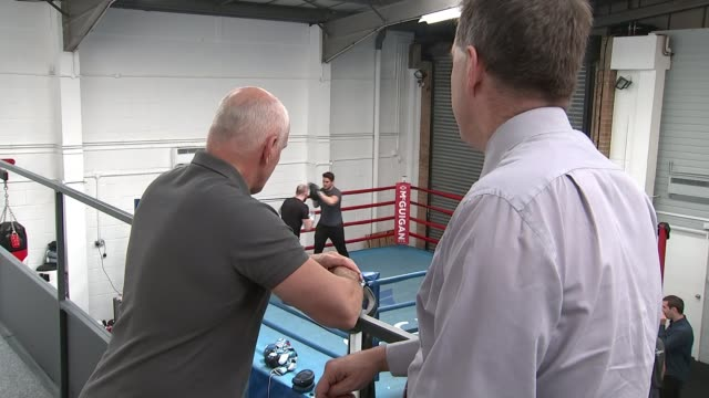 Conor McGregor to face Floyd Mayweather in boxing showdown ENGLAND London McGuigan Gym INT Various shots of men sparring in boxing ring during...
