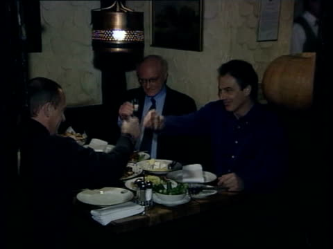 Moscow Blair sitting at table in bar with Russian President Vladimir Putin as drinking vodka TGV Blair Putin sitting at table eating drinking MS...