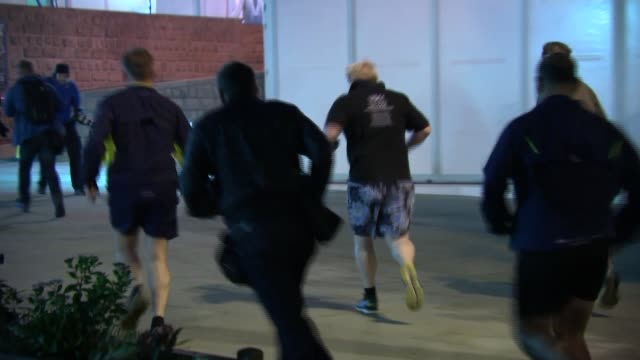 Boris Johnson jogging / Theresa May leaving hotel ENGLAND Manchester PHOTOGRAPHY*** Boris Johnson MP leaving hotel with security to go on run PAN to...