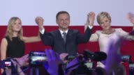 Conservative opposition challenger Andrzej Duda on Sunday won Polands presidential run off exit polls showed trumping incumbent centrist Bronislaw...