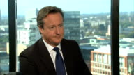 David Cameron interview ENGLAND West Midlands Birmingham INT David Cameron shaking hands with reporter Tom Bradby as they take seats/ David Cameron...