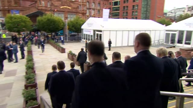 Day 3 Boris Johnson departs conference centre ENGLAND Manchester EXT Boris Johnson MP surrounded by others as along from conference centre to hotel...