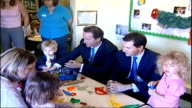 Proposals to put family life first / George Osborne speech **BEWARE ENGLAND Bournemouth INT David Cameron MP talking to young boy at table as holds...