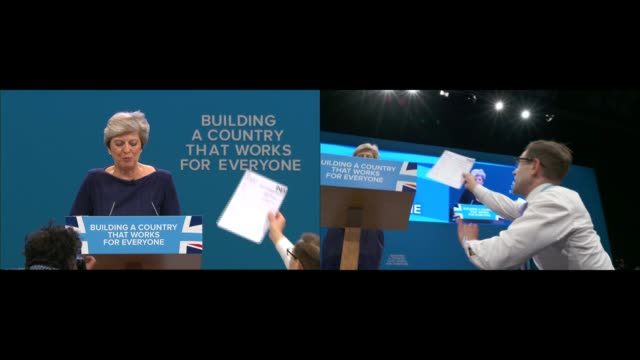 Theresa May speech ENGLAND Manchester INT **Music heard SOT** Theresa May MP arriving on stage at Conservative Party Conference to standing ovation...