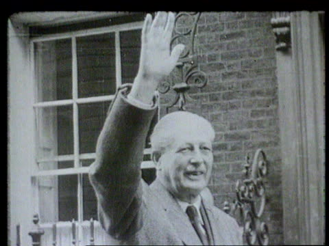 Economy ITN LIB Downing Street No 10 MS Woman in car CMS Harold MacMillan waving MS Car with ribbons on towards PAN LR as past with Harold MacMillan...