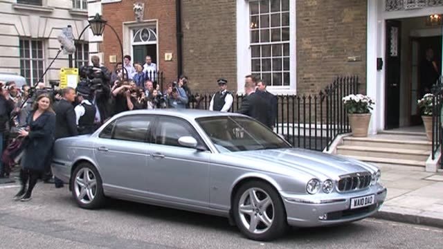 Conservative Party leader David Cameron departs from his first press conference after the results of the general election lead to a hung parliament...